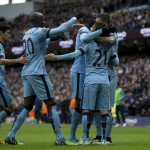 The Manchester City players celebrate after David Silva gave the home side a 2-0 lead