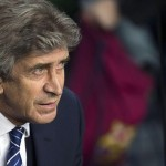City boss Pellegrini looks on as his side get beaten by Barcelona