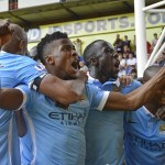 Iheanacho celebrates with his City team mates after his 90th minute winner have Pellegrini the win