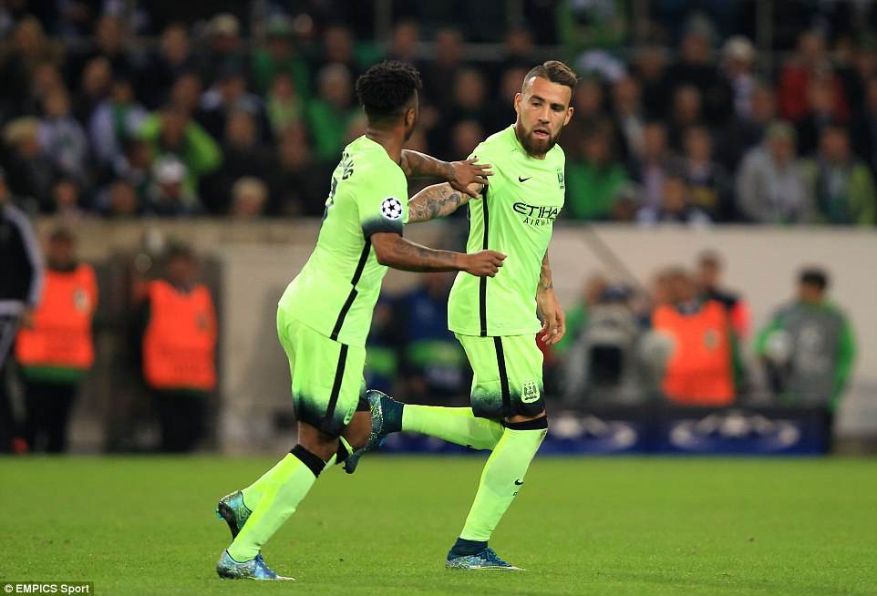 Nicolas Otamendi celebrates with Raheem Sterling  after scoring City's equaliser on the night