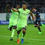 Sergio Aguero wheels away to celebrate after slotting home a late penalty that gave City victory over Borussia Monchengladbach
