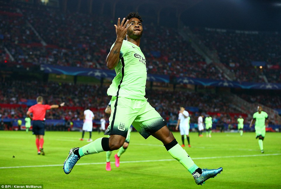 Raheem Sterling celebrates after opening the scoring by coolly slotting the ball past the opposition 'keeper